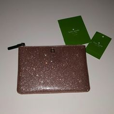 "Brand new Kate Spade rose gold mini pouch Brand new and never worn. Measured 6.5""x4.5"" kate spade Bags Mini Bags"