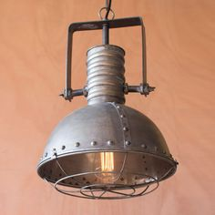Even the kitchen can benefit from some rugged industrial inspiration. Add this rough-and-tumble pendant light above a kitchen island or breakfast bar. Its heavy-duty rivets go perfectly with its antiqu...  Find the Riveted Caged Pendant Lamp, as seen in the Pendants Collection at http://dotandbo.com/category/lighting/chandeliers-and-pendants/pendants?utm_source=pinterest&utm_medium=organic&db_sku=KLL0236