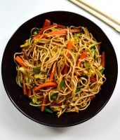 This vegan chow mein is quick and easy to put together witht fresh carrots, cabbage and spring onions stir-fried in a savory soy-sesame sauce. A delicious vegan or vegetarian main dish for when you're craving take-out!