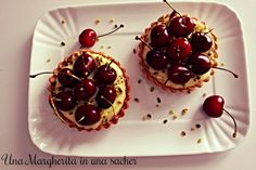 #unamargheritainunasacher Summer air , tall leafy trees , lying on a branch there is a little blonde girl stained with cherry juice .
