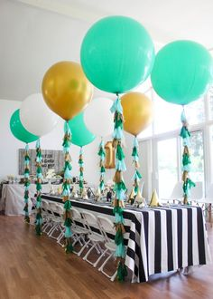 #gold, #balloon, #birthday-party, #stripes, #tablecloth, #party-decor, #black-and-white, #green Photography: Matthew Levi - www.matthewlevi.com Read More: http://www.stylemepretty.com/living/2014/06/13/geometric-first-birthday/