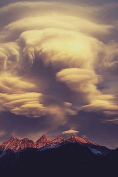 ...stacks of lenticular clouds over the mountains.