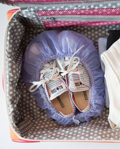Keep the dirty soles of your shoes away from your clothes by sticking them inside a shower cap.
