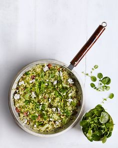 The addition of crispy bacon, crumbled goat's cheese and a zesty pesto made with watercress, anchovies and garlic takes this risotto from a weeknight dinner to a special dinner party dish.