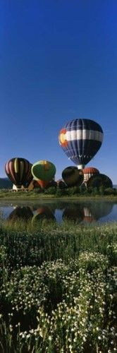 Reflection of hot air balloons in a lake (Blue), Hot Air Balloon Rodeo, Steamboat Springs, Routt County, Colorado, USA Poster Print by Panoramic Images (12 x 36)