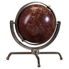 Tabletop globe in brown with a weathered aluminum frame.   Product: GlobeConstruction Material: Aluminum, paper, foam and plasticColor: BrownDimensions: 12 H x 11 Diameter