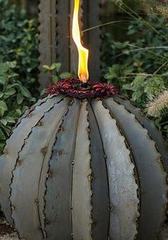 Bring the ambiance of the desert into your outdoor space while shining a warm light on your parties with the Ferocactus Torch; a unique piece so detailed, your guests will think it's real.