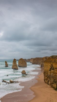 The edge of Australia - 12 Apostles. Visit the Twelve Apostles and explore the scenic Great Ocean Road in 2 days. Find out where you should stop on this world renowned scenic drive in Australia. Holiday Destinations, Amazing Destinations, Places To Travel, Places To Go, Ocean Wallpaper, Beaches In The World, Cool Photos, Amazing Photos, What A Wonderful World