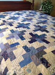 Scrappy quilt is so appealing in blue palate.