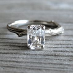 Emerald Cut White Sapphire Twig Engagement Ring, One Carat. $975.00, via Etsy.