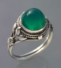 ARTIFICERS' GUILD  Arts & Crafts Ring     Silver & chalcedony  Diameter: 1.3 cm (0.5 in)  British, c.1905