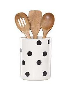 what a crock! this polka-dotted vessel, complete with three wooden utensils, is an ideal housewarming gift.