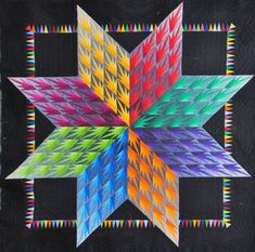 """Lone Star by Lessa Siegele (Looks like Karen Stone's """"Unusual Lone Star"""" paper piecing pattern with broken-up diamonds -- Her patterns are so good to use as a base for improvisation and colorplay.) Very cool use of the pennants in inset border and the graduated grays background to the bright colors of the diamonds. Llink goes to Quilters Guild of South Australia show with many fine photos"""