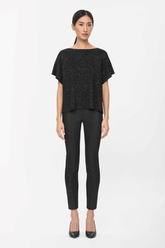 Made from fine milano knit with a metallic finish, this top is a square shape with modern split sides and set-in short sleeves. A loose, boxy fit that is slightly cropped, it has a wide round neckline, dropped shoulder seams and neat, clean edges.