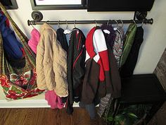 towel bar + shower curtain hooks = coat rack (hang low so kids can reach) here is my lack of closet space solution!