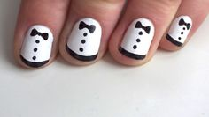 I LOVED Zooey Deschanel's tuxedo nails at the Golden Globes.