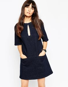 This super easy throw on denim dress just got a whole lot better with the key hole detailing!