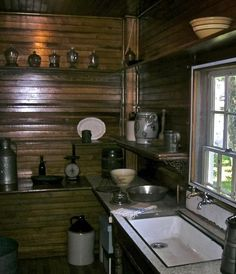 The ancient style kitchen that has a corner covered with wooden shelves to place all the articles.