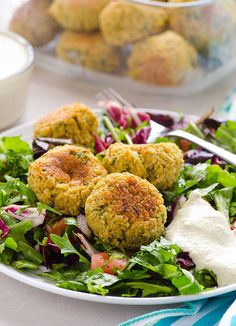Clean Eating Quinoa Falafel with Tahini Sauce -- Crispy on the outside and moist inside, serve with Tahini sauce and fresh greens and lemon salad. Freeze leftovers for busy weeknights. #vegan #glutenfree