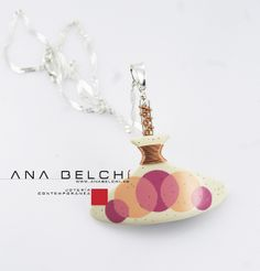 Lovely polymer clay pendant by Ana Belchi. And one of the few examples of wire wrapping I've seen that I like.