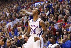 Kansas guard Travis Releford celebrates a three by teammate Ben McLemore during the second half ~ 12.29.12