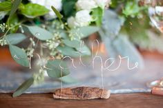 This wedding (http://stylemepretty.com/2012/04/06/wine-country-wedding-by-christina-diane-wedding-photography/) is so full of details! The bride made wired name place settings for each guest. Photography by christina-diane.com
