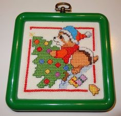 Finished-Cross-Stitch-Christmas-ornament-of-Raccoon-decorating-the-tree