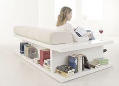 click thumbnails for larger pics We've been seeing this look everywhere lately; sofas with wraparound or built-in shelving are hot right now. Besides combining two functions in one space, the great thing about this idea is its DIY potential. All you need are a couple of low bookshelves and a large enough space to recreate this arrangement at home...