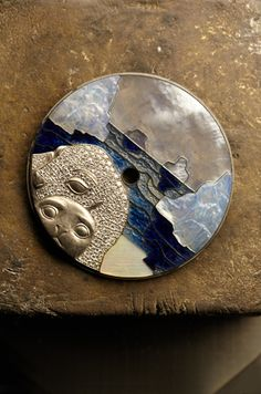 VCA Mother-of-pearl engraving and marquetry