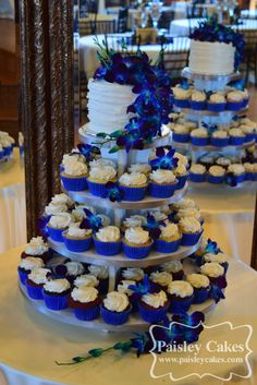 Royal Blue and Purple Cupcake Tower Wedding Cake with Orchids. Made by Paisley C… Royal Blue and Purple Cupcake Tower Wedding Cake with Orchids. Made by Paisley Cakes, Blackfoot Idaho. Blue Wedding Cupcakes, Royal Blue Wedding Cakes, Cupcake Tower Wedding, Purple Cupcakes, Royal Blue Wedding Decorations, Royal Blue Centerpieces, Wedding Ideas Royal Blue And Silver, Royal Blue Cake, Wedding Colors