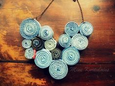 Yo-yo Necklace made from recycled jeans.>>. embellish ac style spirals on skirt