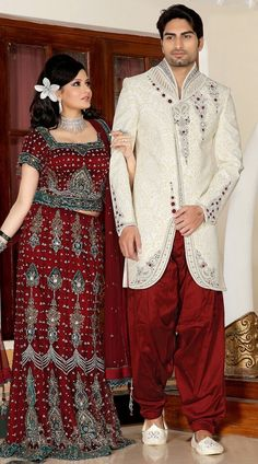 Lovely white brocade readymade sherwani which is adorned with butta, lace, moti, resham and stone work all over. Stole and mojari can be purchased additionally. They are not a part of this sherwani.