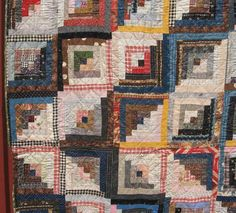 Log Cabin Quilts started to be made after the Civil War. Great variety of fabrics, including neons, vermiculite, ditzies, mourning prints, Lancaster blue, cadet blue, indigo, bright blue and black floral stripe, black and red, and drabs. Some of the prints have pineapples and botehs.
