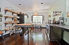 Eclectic Home in Austin, Texas [This kitchen is AMAZING! I love the open shelving and the work surfaces. The sink is cool too! Perfect kitchen in a small jewel of a house. The exact thing for me I think!]