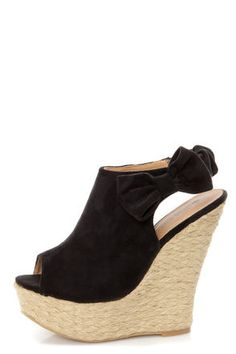 Check it out from Lulus.com! Log some clog time and see what all the fuss is about! The Wild Diva Lounge Kendall 17 Black Peep Toe Clog Platform Wedges take a slide silhouette in vegan suede and add a fun peep toe, as well as an elasticized slingback with a pretty side bow for a girly flair. Espadrille platform builds from 1.75