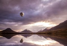 Hot air balloons over mountains