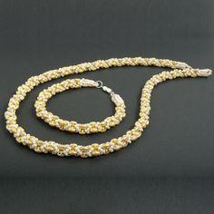 beaded handmade set - bracelet and necklace - netted from Toho beads and SuperDuo Beads  #MARIBOjewelry #handmade #beaded #necklace #beading #bead #beads #beadingcommunity #beadshop #jewelry #jewellry #jewels #beatifuljewelry #elegant #tohobeads #toho #romaniabrands #handmadeinromania #romania #bijuterii #bijuteriihandmade #fashionblogger #jewelrydesigner #jewelrytrend #beadworks #fashionista #influencer #beatifuljewelry #instajewelry #bracelet