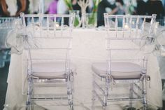 We're a little obsessed with how amazing our clear Chiavari chairs look with silver cushions and these beautiful bows at the sweetheart table! Thanks Gian Carlo Photography for the awesome photo! Pair these with our new acrylic table for the perfect combination!