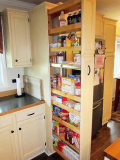 Concealed Pantry Maximizes Space  ~ Great pin! For Oahu architectural design visit http://ownerbuiltdesign.com