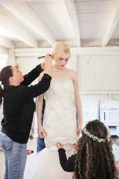 Prepping model, Clara, in our 'Delphine' gown at our last photoshoot at The Ashford Estate. #sarehnouri