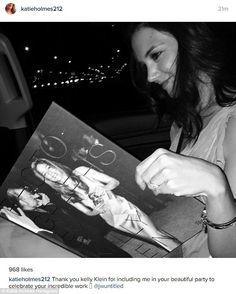 Her first book:The event was held to celebrate the release of a photography book by Calvi...