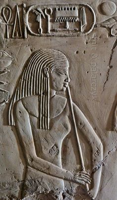 """'Flutist in Kheruef's tomb at Luxor.' This relief detail in the tomb of Kheruef shows a flutist who performs on the occasion of the First Jubilee (heb sed) festival of Amenhotep III, whose cartouche can be seen at the top of the picture. Kheruef was steward of Queen Tiy, the wife of Amenhotep III, and played an important role during festivals. His (unfinished) tomb (TT 192) can be found in the Asasif Necropolis on the Westbank at Luxor. It is one of the socalled """"Tombs of the Nobles""""."""