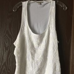 White Beaded tank top from Banana Republic Beautifully beaded true white tank top from Banana Republic.    Only worn just one time and decided it wasn't for me.   Size XL and it does have extra space around the armpit areas.    Buyer will need a tank top to go underneath because back is sheer.  Lining only covers front of top where the beading is located.   100% polyester, machine washable.   No missing beads, stains or tears. Banana Republic Tops Tank Tops