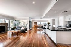 The floor is such a feature - it looks like spotted gum, it works well with the light interior