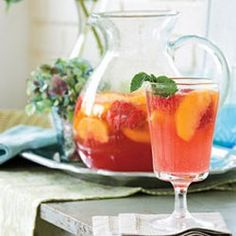 Carolina Peach Sangria 750 mls wine (ros) 3/4 cup vodka 1/2 cup peach (nectar) 6 tbsps frozen lemonade concentrate (thawed) 2 tbsps sugar 1 lb peaches (ripe, peeled and sliced) 6 ozs raspberries (fresh) 2 cups club soda (chilled)