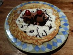 Pancake with whipped cream, Caroline's Dairy Belgian Choc ice cream, dark choc sauce and glace cherries