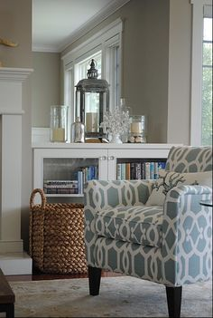 I really like this! Everything from the decorative items to the chair. Laura