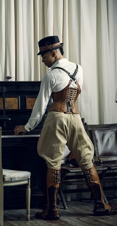 Tailored Cincher corset by Dark Garden in brown leather: $470 / Photo: Joel Aron / Model: Brandon