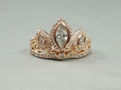 Inspired by the fairy tale Rapunzel, this custom designed ring features crystal accent stones set in a princess tiara design plated with rose gold over