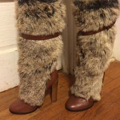 Knee height Colin Stuart faux fur boots Gorgeous, hardly warn knee high faux fur boots. Buckle accent around shaft and at top of shoe. Fur is a mixture of black, cream and grey. Colin Stuart Shoes Heeled Boots